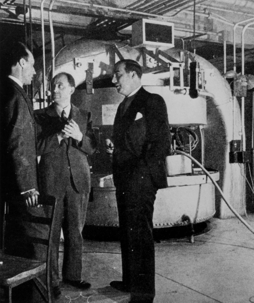Fermi, Dunning, and Mitchell converse in front of the Columbia Cyclotron